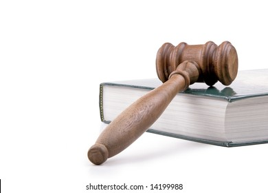Wooden gavel and textbook.  Isolated on white.