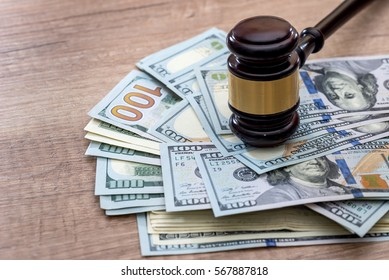 wooden gavel with usa dollar on desk. close up. macro