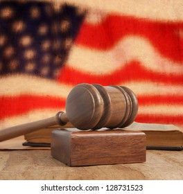 Wooden gavel and vintage USA flag
