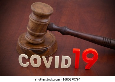 Wooden gavel with word covid19. Laws and decisions against covid-19.