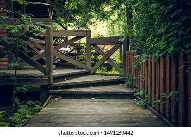 wooden gazebo hand made object entrance with stairs and fence in forest park outdoor cozy natural environment fore relaxation and rest in open fresh air