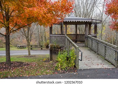 A wooden gazebo surrounded by Autumn colors in Smithville Village in Nurlington County New Jersey.