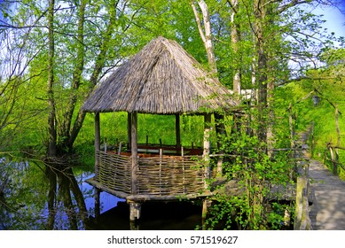 A wooden gazebo in the Ukrainian national traditions in the rate