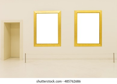 wooden golden photo frames on wall in exhibition gallery