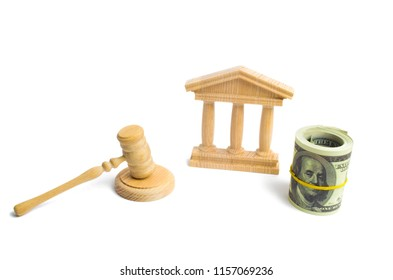 wooden government building Judge's hammer and money, on a white background. concept of state administration and economic institutions. Municipality, government, elections. Reforms, sanctions. Bank