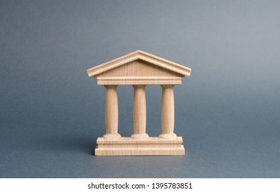 wooden government building on a gray background. The authorities, the sovereignty of the country and the rule of law. concept of state administration and economic institutions. Bank or university