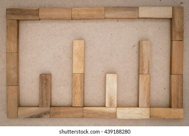 a wooden graph with pattern block