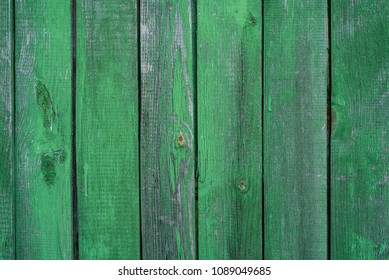 Wooden green background, stained with age and some paint peeling off