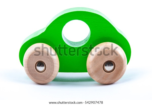 Wooden green car isolated on white background