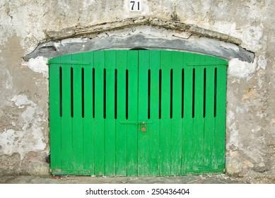 Wooden green door of a boat shelter in Majorca
