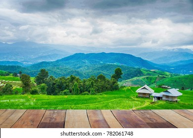 wooden and green terraced rice field with mist on morning in Pa Bong Pieng, Chiang Mai, Thailand.