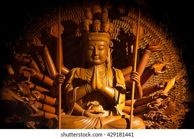 Wooden Guanyin buddha statue with thousand hands in Thailand