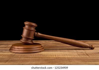 wooden hammer on a black background