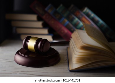 Wooden hammer on the books background