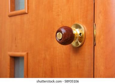 wooden handle of the door