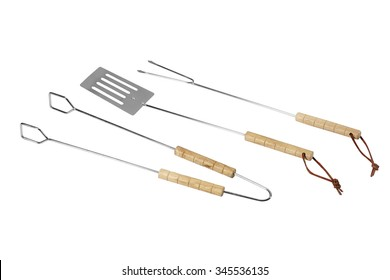 wooden handle on a white background tongs, fork and spatula