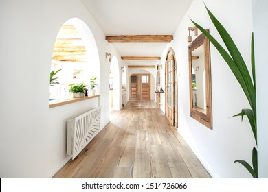 Wooden handmade mirror in hallway boho interior. Home indoors design concept.