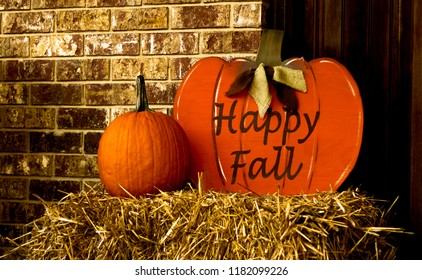 Wooden Happy Fall Pumpkin on bale of hay and real pumpkin for outdoor autumn/fall decorations