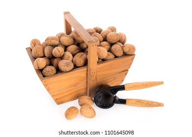 Wooden harvest baskets full walnuts isolated over white background