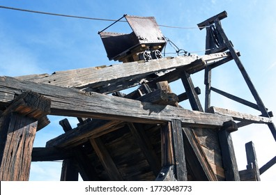 Wooden head frame and old mining cart in the abandoned mining town of Vulture City, Arizona