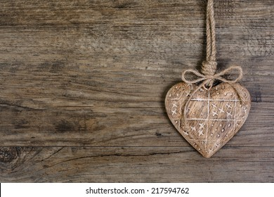 Wooden heart decoration on vintage oak background, space for your text