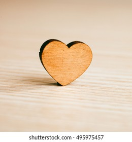 wooden heart on wooden background.love concept. background for greetings Valentine's day