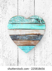 wooden heart on grungy wooden texture