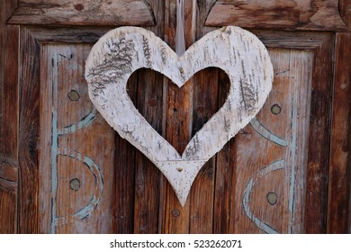 Wooden heart on a natural background, symbol of love