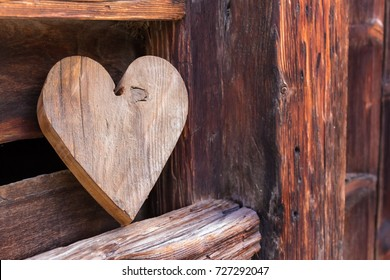 Wooden heart outside of a rustic barn as a sign for welcome home