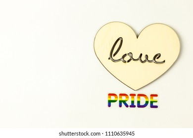 Wooden heart and rainbow pride word
