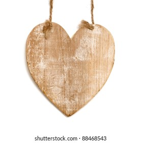 wooden heart with rope isolated on white