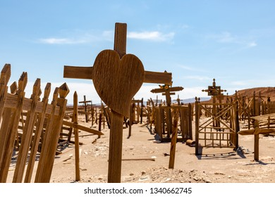 Wooden Heart Shaped Cross  in Abandoned Cemetery in the Atacama Desert, Northern Chile. From the era of nitrate mining  - Selective Focus