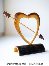 wooden heart statuette on white background