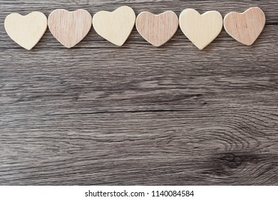 Wooden hearts on a wooden background
