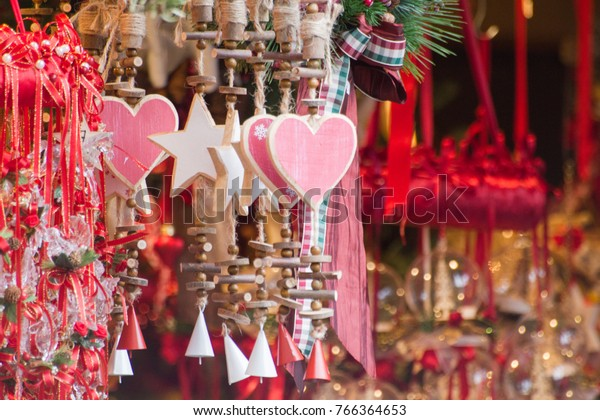 Wooden hearts and stars ornaments with small red and white bells