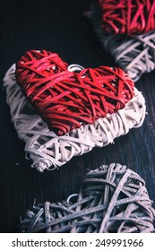 Wooden heart-shaped pattern on the wooden background