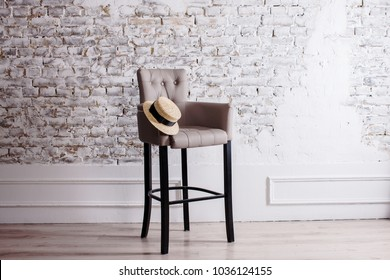 Wooden high Black Chair on the Background of a spacious Room in the style of Minimalism (white brick Wall) Scandinavian style, cozy simplicity and Comfort, Home Minimalism interior with copy space