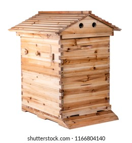 Wooden hive with detachable roof, access holes for bees and side access door for honey collecting