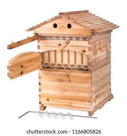 Wooden hive with detachable roof, access holes for bees and open access door for honey collecting, reservoir with tap, handle and glass tubes isolated on white background