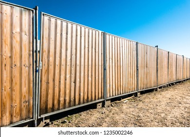 wooden hoarding wall at a construction site