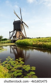 Wooden hollow post mill with a thatched under tower and a paddle wheel near the village of Molenaarsgraaf, Alblasserwaard, South Holland, Netherlands. The now restored mill dates from about 1655.