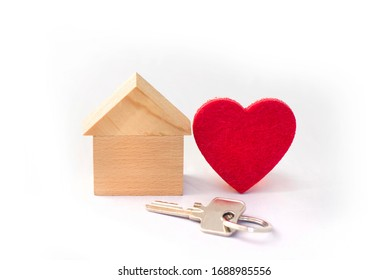 Wooden Home with red heart on white background, concept, symbol