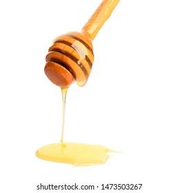 Wooden honey dipper on white background