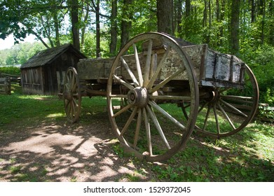 Wooden horse wagon next to a barn of a homestead in the USA