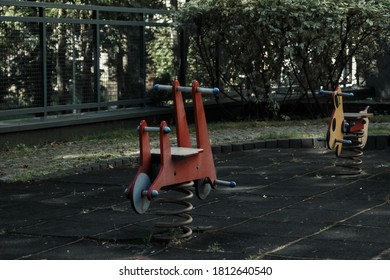 wooden horses on an empty playground for children