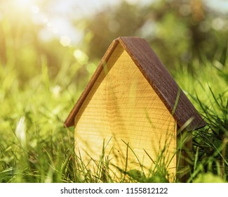 Wooden House. Abstract energy savings and eco construction backgrounds