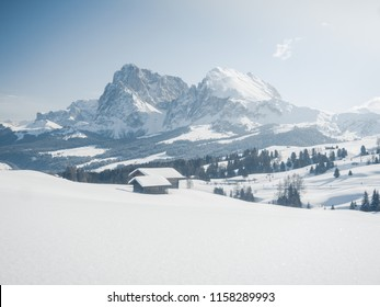 Wooden house Alpe di Siusi or Seiser Alm the Langkofel mountain range with Bolzano province, South Tyrol in Dolomites at Italy, Winter 2018