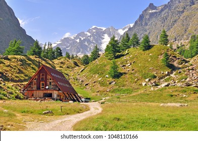 Wooden house in Alps, Italy