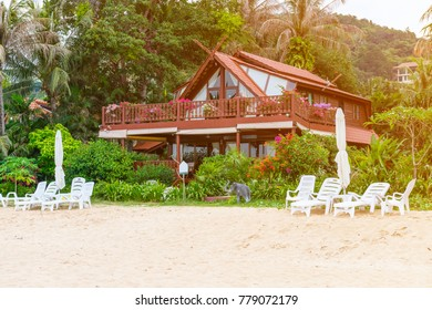 Wooden house in beautiful tropical nature with sand beach Ñ?Ñ?в chaise-longue on the front