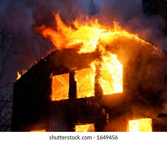 Wooden house burning.